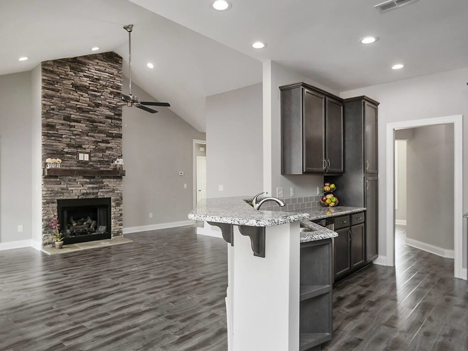 Kitchen and great room of The Valmead Park plan 1153.