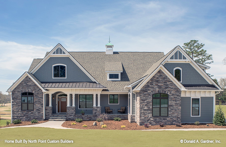 Front exterior of The Austin house plan 1409.