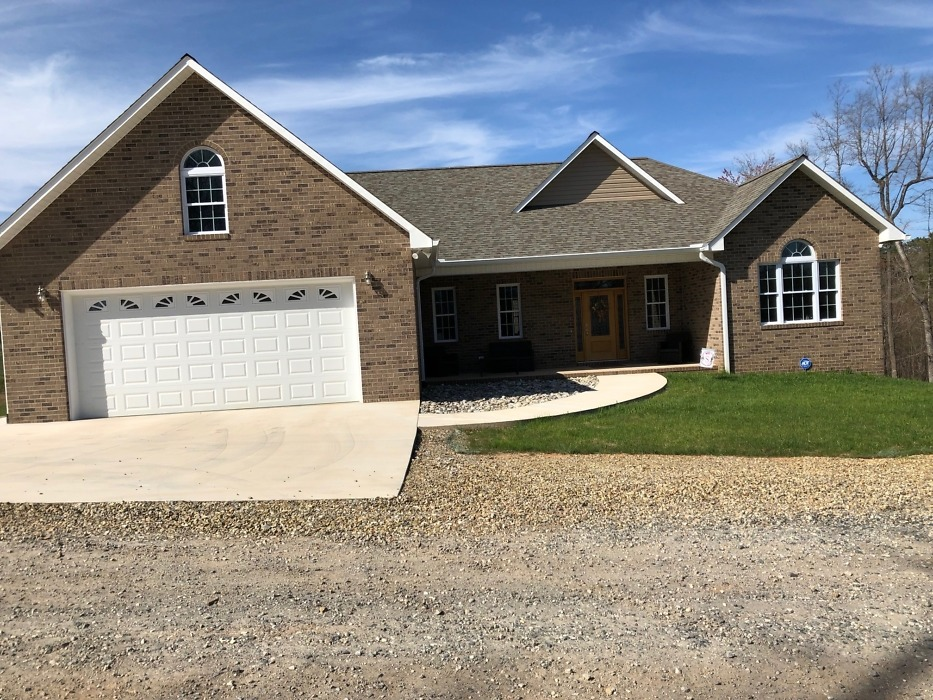Front exterior of The Carrollton home plan 1229.