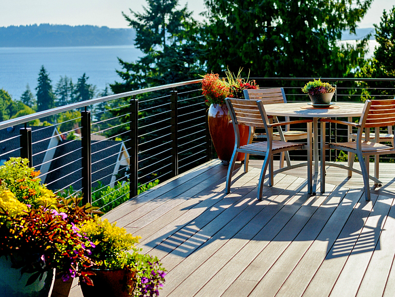 Outdoor living trends include landscaping and potted plants.