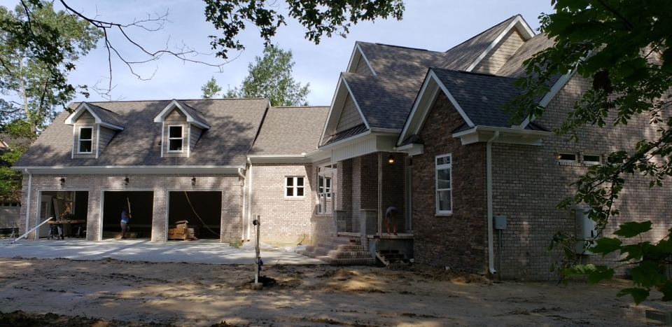 Exterior finishes of The Bluestone Plan 1302.