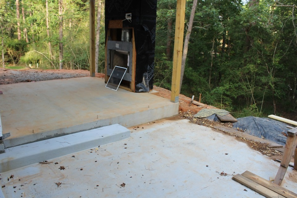 Concrete driveway and parking pad.